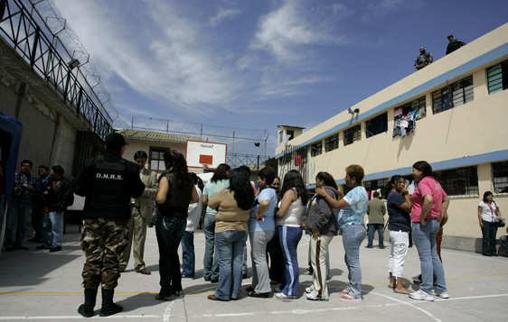 Inmates line to vote at the women's prison in Quito, Friday, April 24