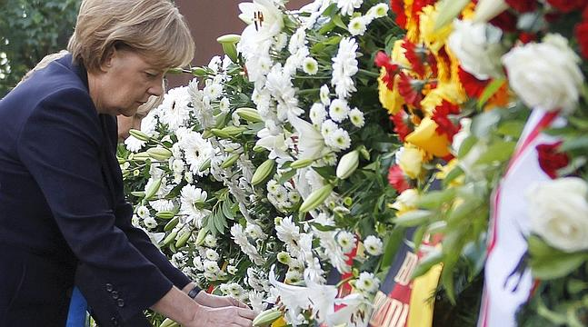 German Chancellor Merkel attends wreath laying ceremony marking 50th anniversary of building of Berlin Wall in Berlin