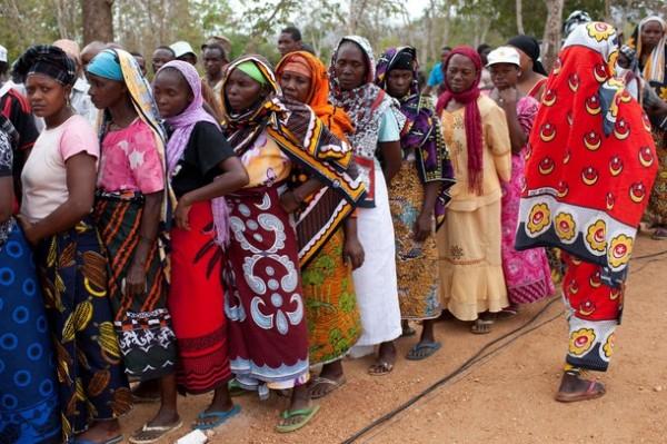 Tanzanian women wait in a line to vote i