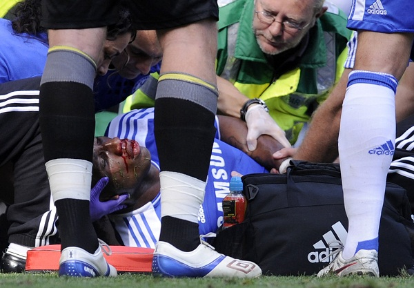 Chelsea's Drogba receives treatment after colliding with Norwich City's John Ruddy and was stretchered off during their English Premier League soccer match in London