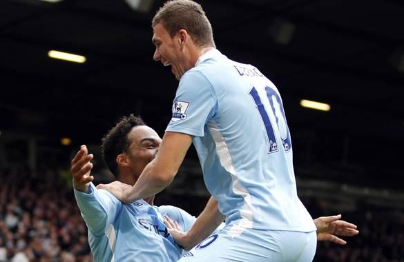 Manchester City's Dzeko celebrates his goal against Manchester United with Lescott during their English Premier League soccer match in Manchester