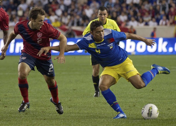 Ecuador's Juan Carlos Paredes kicks the ball past United States' Steve Cherundol in Harrison