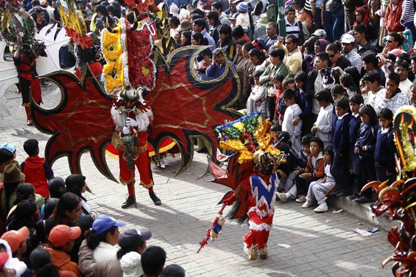 "Dancers perform ""Diablada"" on the streets of Pillaro"