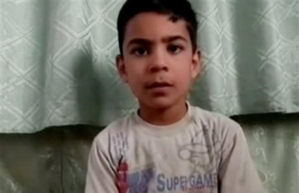 Imagen tomada de un video y difundida por Houla Media Office el jueves 31 de mayo del 2012 de Alí el-Sayed, un niño de 11 años que sobrevivió a una matanza en Siria haciéndose el muerto en Houla, en la provincia de Homs. Más de 190 personas fueron masacradas. (Foto AP/Shaam News Network víaa AP video)