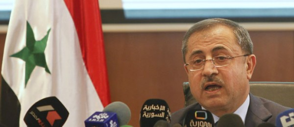 Syria's Interior Minister Mohammed al-Shaar speaks during a news conference announcing the results of the referendum on a new constitution in Damascus