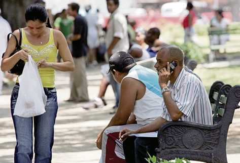 A Cuban talks by his new cell phone, on May 8, 2008, in Havana. Since May 2, 2008 Cubans are allowed to purchase cell phones or computers for personal use, something previously limited to state companies and foreigners.       AFP PHOTO/ADALBERTO ROQUE