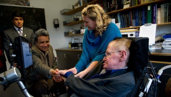 Ecuadorean Vice-President Leni?n Moreno (2L) greets with famous Britan scientis Stephen W. Hawking as his assitent Niki Joyce helps him, during a visit at the Applied Mathematics Departmen in the University of Cambridge August 30, 2012. Moreno talks with Hawking about his discapable helping program Manuela Espejo and invited him to vist Galapagos and the Yasuni. REUTERS/HAND OUT Guillermo Granja Vicepresidencia-Ecuador