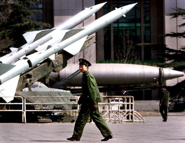 BEIJING, CHINA:  A People's Liberation Army (PLA) soldier walks past missiles 19 March 2000 on display in front of the Military Museum in Beijing, which showcases China's military achievements and weapons.  Foreign military experts in the Chinese capital said there were no signs of increased military activity after the elections in Taiwan 18 March.  After weeks of strident threats aimed at scaring Taiwanese voters away from pro-independence candidate Chen Shui-bian, a muted China reacted with moderation and pragmatism to his stunning victory in the island's presidential elections.       (ELECTRONIC IMAGE)     AFP PHOTO/Stephen SHAVER (Photo credit should read STEPHEN SHAVER/AFP/Getty Images)