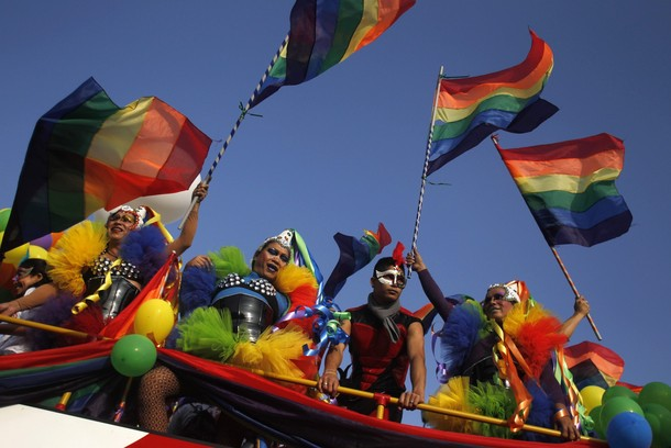 Revelers take part in a Gay Pride parade in Lima
