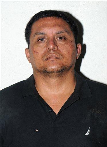 En esta foto publicada el 16 de julio de 2013 por la Armada de México aparece el líder del cartel de los Zetas Miguel Ángel Treviño Morales tras su arresto en México. (Foto AP/Armada de México)