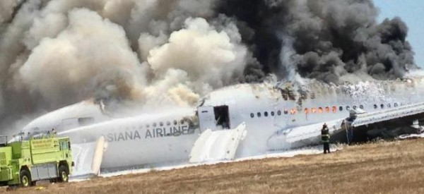 Asiana Airlines Boeing 777 is engulfed on the tarmac after crash landing at San Francisco International Airport in San Francisco