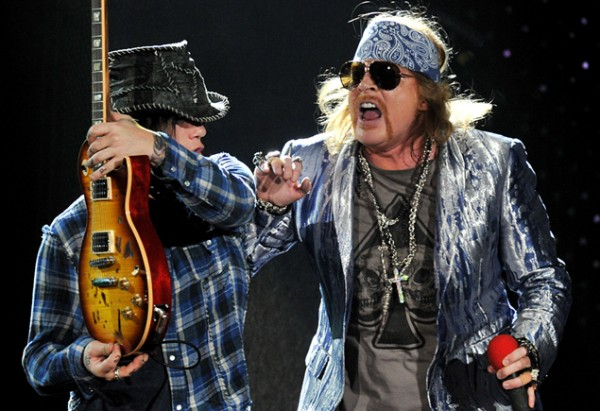 U.S. band Guns N' Roses guitarist DJ Ashba, left, and singer Axl Rose perform on their first night at London's O2 Arena, on Wednesday, Oct. 13 2010. (AP Photo/Mark Allan)