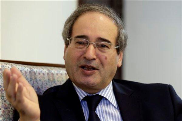 El subsecretario sirio de Relaciones Exteriores Faisal Mekdad en una entrevista con The Associated Press en su oficina en Damasco, Siria, el lunes 26 de agosto de 2013. (Foto AP/Hassan Ammar)