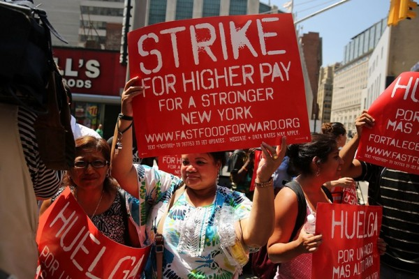 NEW YORK, NY - JULY 29: Employees and supporters demonstrate outside of a Wendy's fast-food restaurant to demand higher pay and the right to form a union on July 29, 2013 in New York City. Across the country thousands of low-wage workers are expected to walk off their jobs Monday at fast food establishments in seven U.S. cities. Workers at KFC, Wendy's, Burger King, McDonald's and other restaurants are calling for a living wage of $15 an hour and the right to form a union without retaliation.   Spencer Platt/Getty Images/AFP== FOR NEWSPAPERS, INTERNET, TELCOS & TELEVISION USE ONLY ==