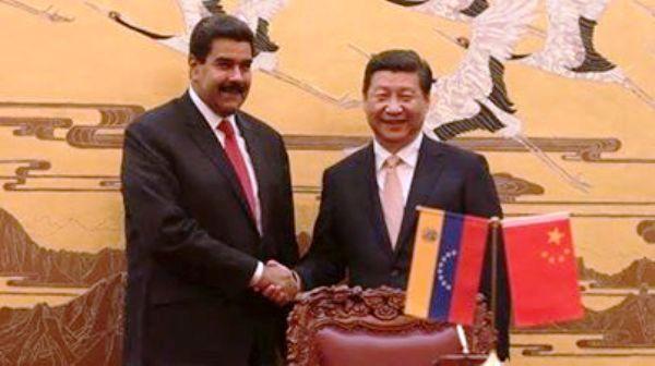 Reunión de los mandatarios de China y Venezuela para otorgar un préstamo del país asiático a la administración de Maduro. Foto de Archivo, La República.