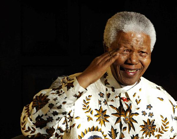 Nelson Mandela, the former South Africa President salutes the South African military health service band that came to play a specially composed march and happy birthday on his 85th birthday, 18 July 2003. AFP PHOTO/ ALEXANDER JOE  (Photo credit should read ALEXANDER JOE/AFP/Getty Images)
