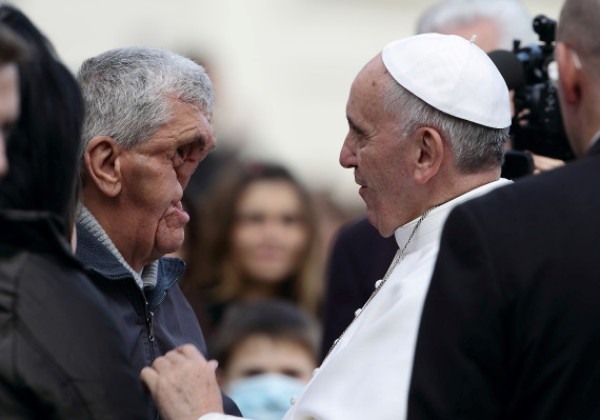 Nov. 20, 2013 - Vatican City State, Italy - POPE FRANCIS blesses a sick man with deformed facial features after his general audience in St. Peter's Square at the Vatican. (Credit Image: © Evandro Inetti/ZUMAPRESS.com)