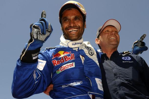 Qatar's driver Nasser Al-Attiyah (L) cel
