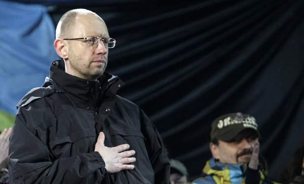 Former economy minister Arseny Yatseniuk stands on the stage during a rally in Independence Square in Kiev