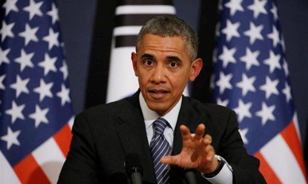El presidente de Estados Unidos, Barack Obama, responde la pregunta de un reportero durante una conferencia de prensa el viernes 25 de abril de 2014 en Seúl, Corea del Sur. En la rueda de prensa participó también la presidenta surcoreana Park Geun-hye, fuera de cuadro. (Foto AP/Charles Dharapak)