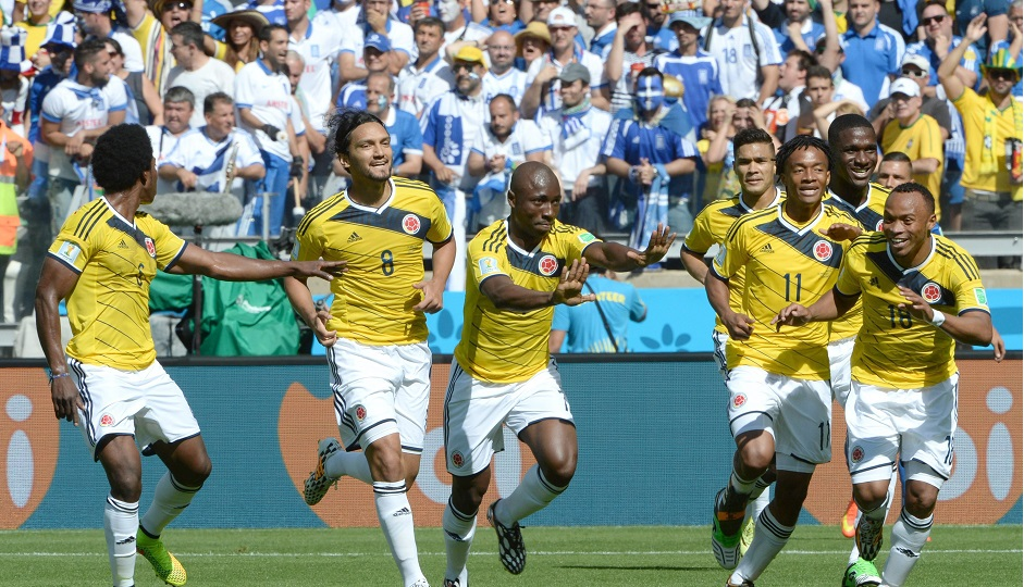 . Belo Horizonte (Brazil), 14/06/2014.- Pablo Armero (C) of Colombia celebrates with teammates after scoring the opening goal during the FIFA World Cup 2014 group C preliminary round match between Colombia and Greece at the Estadio Mineirao in Belo Horizonte, Brazil, 14 June 2014. AP