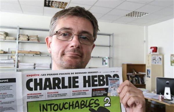 """Stephane Charbonnier, conocido como Charb, el director del semanario satírico francés Charlie Hebdo, en una foto del 19 de septiembre de 2012. Charb es una de las 12 personas que murieron el 7 de enero de 2015 cuando tres hombres armados gritando """"¡Allahu akbar!"""" (Dios es grande) atacaron las oficinas del semanario en París. (Foto AP/Michel Euler, File)"""