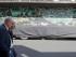 """Personas caminan en París el sábado 30 de mayo de 2015 frente a un remolque en el que el artista callejero británico Banksy pintó una obra llamada """"Silent Majority"""". La obra es exhibida frente a la casa de subastas Digard, en París, que la sacará a la venta el lunes.(AP Foto/Jacques Brinon)"""