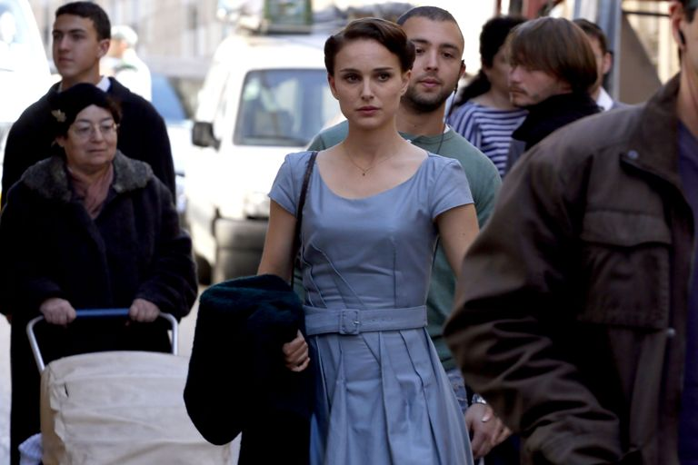 "Oscar winning star Natalie Portman acts in a scene of a new film she is directing herself on February 13, 2014 in Jerusalem. Portman is in the city to work on a film adapted from Israeli novelist Amos Oz's acclaimed memoir ""A Tale of Love and Darkness"", which has been translated into 28 languages and has sold over a million copies worldwide. The film details Oz's childhood in Jerusalem in the chaotic period at the end of the British mandate in Palestine, as well as the writer's experiences during the early years following the establishment of the the state of Israel and his teenage in a kibbutz. Portman, who was born in Jerusalem to an Israeli father and an American mother, plays a supporting role as Oz's mother. AFP PHOTO/GALI TIBBON"