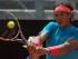 Rafael Nadal devuelve una pelota ante John Isner en el Abierto de Italia el jueves, 14 de mayo de 2015, en Roma. (AP Photo/Andrew Medichini).