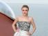 La actriz Dakota Fanning llega al desfile Dior Resort presentado en Cannes, en el sureste de Francia, el lunes 11 de mayo de 2015. (AP Foto/Lionel Cironneau)