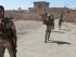 En esta foto del domingo 26 de abril del 2015, fuerzas de seguridad de Irak patrullan durante una operación contra el grupo extremista Estado Islámico para recapturar una estación de control de agua en un canal perdido el fin de semana en el pueblo de Garma, entre Bagdad y la ciudad de Faluya, en poder del Estado Islámico. (Foto AP)