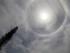 Un halo solar ilumina el cielo durante la ceremonia de beatificación de monseñor Oscar Romero en San Salvador, El Salvador, el sábado 23 de mayo de 2015. (AP Foto/Moises Castillo)