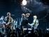 """De izquierda a derecha Larry Mullen Jr., The Edge, Bono y Adam Clayton, de U2, durante el concierto de la banda en el Forum de Inglewood, California, parte de su gira """"Innocence + Experience"""", el martes 26 de mayo del 2015. (Foto por Rich Fury/Invision/AP)"""
