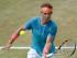 Foto de archivo. El español Rafael Nadal devuelve un tiro del australiano Bernard Tomic durante su partido de cuartos de final en Stuttgart, Alemania, el viernes 12 de junio de 2015.  (Marijan Murat/dpa, via AP).