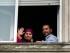 El ex prisionero de Guantánamo Adel bin Muhammad El Ouerghi, de Túnez, está junto a su novia uruguaya Roma Blanco que saluda a los periodistas, después de la ceremonia religiosa en su casa de Montevideo, Uruguay, el viernes 5 de junio de 2015.  (AP Photo/Matilde Campodonico)