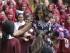 La primera dama estadounidense Michelle Obama es recibida por estudiantes de la Escuela para Niñas Mulberry en Londres, el martes 16 de junio del 2015. (AP Foto/Matt Dunham)