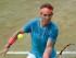 El español Rafael Nadal devuelve un tiro del australiano Bernard Tomic durante su partido de cuartos de final en Stuttgart, Alemania, el viernes 12 de junio de 2015.  (Marijan Murat/dpa, via AP).