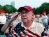 Richard Garcia, de Victoria, Texas, saluda al escuchar el himno nacional durante un ensayo general del concierto por el 4 de julio, Día de la Independencia de EEUU, en el Hatch Shell en Boston, el viernes 3 de julio de 2015. (Foto AP/Michael Dwyer)