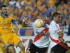 MONTERREY (MÉXICO), 29/07/2015.- Andre Gignac (i) de Tigres de México disputa el balón con Jonathan Maidana (c) de River Plate de Argentina hoy, miércoles 29 de julio de 2015, durante el partido de ida de la final por la Copa Libertadores en el estadio Universitario de Monterrey (México). EFE/Miguel Sierra