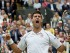 Novak Djokovic of Serbia celebrates winning against Roger Federer of Switzerland during their final match for the Wimbledon Championships at the All England Lawn Tennis Club, in London, Britain, 12 July 2015. (Tenis, Suiza, Londres) EFE/EPA/ANDY RAIN.