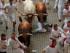 Un mozo cae al suelo mientras otros siguen corriendo junto a los toros de la ganadería Jandilla en el primer encierro de las fiestas de San Fermín, en Pamplona, España, el martes 7 de julio de 2015. (AP Foto/Daniel Ochoa de Olza)