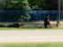 En esta imagen de un video emitido por WRCB-TV, las autoridades acuden a la escena de un tiroteo en curso cerca de ll Centro de Reserva Naval en Chattanooga, Tennessee, el jueves 16 de julio de 2015.  (WRCB-TV via AP) MANDATORY CREDIT