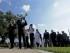Músicos encabezan el sábado 29 de agosto de 2015 una procesión durante una ceremonia de colocación de una ofrenda floral en un monumento a las víctimas del huracán Katrina, en el décimo aniversario de esa tempestad que azotó Nueva Orléans. (AP Foto/Gerald Herbert)