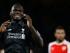 Christian Benteke reacciona tras fallar una oportunidad de gol por el Liverpool frente al Arsenal, en un cotejo de la Liga Premier, realizado el lunes 24 de agosto de 2015 (AP Foto/Kirsty Wigglesworth)