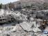 Esta foto difundida por el grupo activista opositor sirio Ariha Today, autenticada con información obtenida por la Associated Press, muestra la escena tras la caída de un avión de guerra del gobierno en el centro de Ariha, en el noroeste de Siria, lunes 3 de agosto de 2015. (Ariha Today via AP)