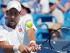 El serbio Novak Djokovic devuelve una pelota ante Stan Wawrinka en los cuartos de final del Masters de Cincinnati el viernes, 21 de agosto de 2015, en Mason, Ohio. (AP Photo/John Minchillo)