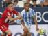 El delantero francés del Sevilla FC Kevin Gameiro (i) lucha por el balón con el venezolano Roberto José Rosales, del Málaga CF, durante el partido de la primera jornada de la Liga de Primera División que ambos equipos disputan esta tarde en el estadio de La Rosaleda, en Málaga. EFE/ Jorge Zapata