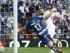 El delantero francés del Real Madrid Karim Benzema (d) marca de cabeza el primer gol ante el portero del Granada, Andrés Fernández (i), durante el partido de la cuarta jornada de la Liga de Primera División que se juega hoy en el Santiago Bernabéu. EFE/Alberto Martín.