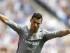 El delantero del Real Madrid, Cristiano Ronaldo, celebra el primer gol de su equipo durante el partido contra el Espanyol en la tercera jornada de la Liga, jugado esta tarde en el Power 8 Stadium de Cornellá-El Prat. EFE/Alejandro García