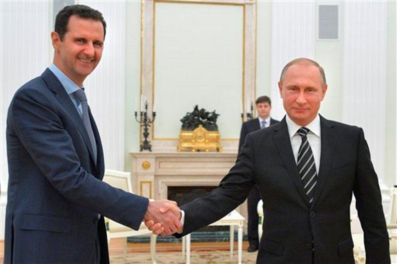 Putin y Assad mano